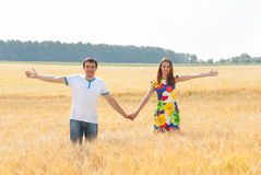 Happy couple in love in the field. Royalty Free Stock Photos