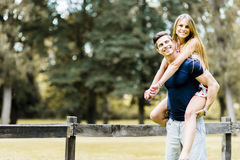 Happy couple in love having fun outdoors Stock Images