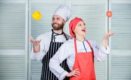 Happy couple in love with healthy food. Family cooking in kitchen. man and woman chef in restaurant. Dieting vitamin. Happy couple in love with healthy food stock images