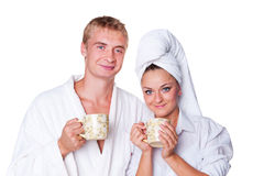 Happy couple in love holding cup of tea Stock Photos