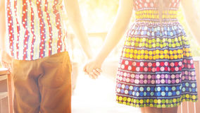 Happy couple in love holding hands walking in the park Royalty Free Stock Photos