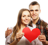 Happy couple in love holding red heart. Stock Photography