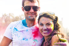 Happy couple in love on holi color festival Stock Images