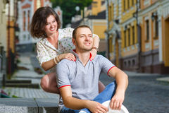 Happy couple in love hugging at city Stock Photo