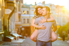 Happy couple in love hugging at city Royalty Free Stock Photos