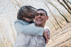 Happy couple in love hugging and sharing emotions, holding hands walking in the park stock images