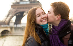 Happy couple in love near the Eiffel Tower Stock Photo