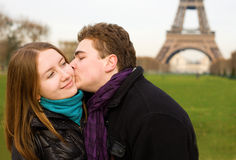 Happy couple in love near the Eiffel Tower Royalty Free Stock Image