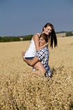 Happy couple in love outdoor in summer on field Stock Image