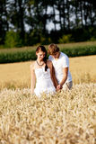 Happy couple in love outdoor in summer on field Stock Images