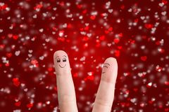 Happy couple in love. Painted at fingers isolated on red background royalty free stock photo