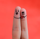 Happy couple in love with painted smiley Royalty Free Stock Images