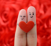 Happy couple in love with painted smiley Stock Photography