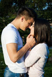 Happy couple in love in a park Stock Photo