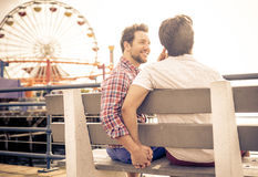 Happy couple in love playing in Santa monica on the beach stock photos