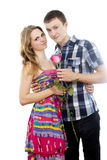 Happy couple in love with a rose. Isolated on white background Stock Photo