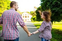 Happy couple in love running at alley Stock Images