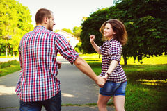 Happy couple in love running at alley. Toned image Royalty Free Stock Image