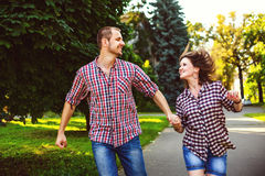 Happy couple in love running at alley. Toned image Stock Photography