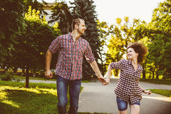Happy couple in love running at alley. Toned image Royalty Free Stock Photos