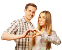 Happy couple in love showing heart with their fingers Stock Photo