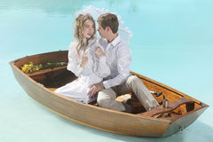 Happy Couple in Love on a Small Boat Outdoors Royalty Free Stock Photo