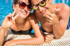 Happy couple in love in swimming pool royalty free stock photo