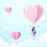 Happy couple in love swings with heart shape balloons in the air Stock Photos