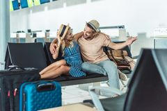 Couple waiting for boarding at airport Stock Photos