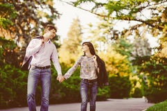 Happy couple in love walking at alley Stock Images