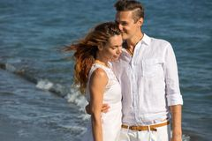 Happy couple in love walking on the beach Royalty Free Stock Photos