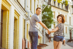 Happy couple in love walking at city. Warm toned Royalty Free Stock Images
