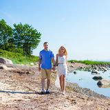 Happy couple in love walking on summer beach Royalty Free Stock Photos