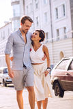 Happy couple in love walking at sunny day. In city Royalty Free Stock Images