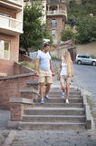 Happy couple in love walking in Tbilisi city, Georgia. Young adults tourists on travel Stock Photo