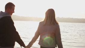 Happy couple in love walks on a quay, rejoices and caresses each other stock video
