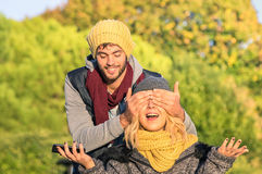 Happy couple of lovers - Handsome man covering girlfriends eyes Stock Photo
