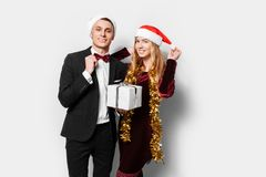 A happy couple of lovers, in Santa Claus hats, celebrates the Ne royalty free stock images