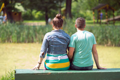 Happy couple. Loving couple on a bench Royalty Free Stock Images