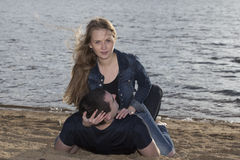 Happy couple lying on the beach Stock Photos