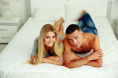 Happy couple lying on the bed Royalty Free Stock Image