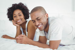 Happy couple lying on the bed Royalty Free Stock Photography