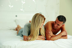 Happy couple lying on the bed Royalty Free Stock Photo