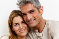 Happy couple lying in the bed Royalty Free Stock Photo