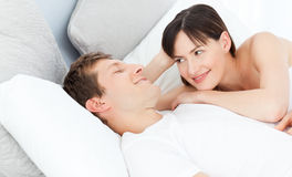 Happy couple lying down together royalty free stock images