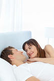 Happy couple lying down together Stock Photo