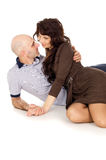 Happy couple lying and flirting  Stock Photography