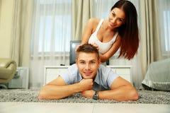 Happy couple lying on the floor Stock Image
