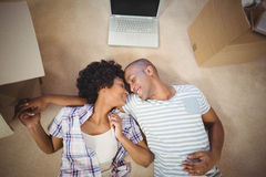 Happy couple lying on the floor Royalty Free Stock Images
