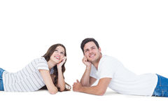Happy couple lying on the floor looking up Stock Photos